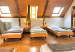 Chambre 1 lit double et 4 lits simples de la location proche de Montoir de Bretagne
